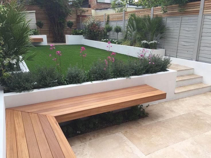 Modern garden design London travertine paving artificial grass raised beds