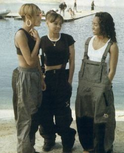 TLC. This look...no words.  I loved wearing baggy overalls with a tight tank or sports bra underneath.  The horror.