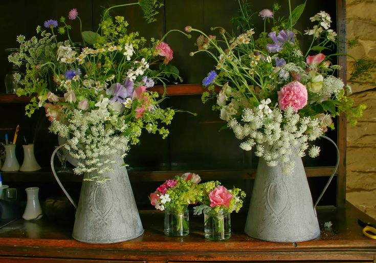 Vintage jugs of flowers and buttonholes. Inspiration for the church hall tables.