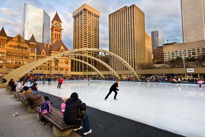 Hedonist's Guide to Gorgeous Urban Ice Rinks - Hg2Magazine.com. Toronto Ice Rink at Nathan Philips Square - Photo Benson Kua