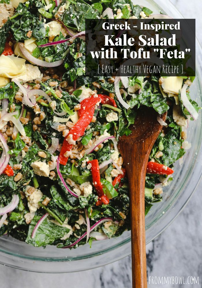 "This Greek-Inspired Kale Salad is loaded with Fresh Vegetables, Hearty Grains, and a Tofu ""Feta"" to make it a satisfying and wholesome meal all on its own."