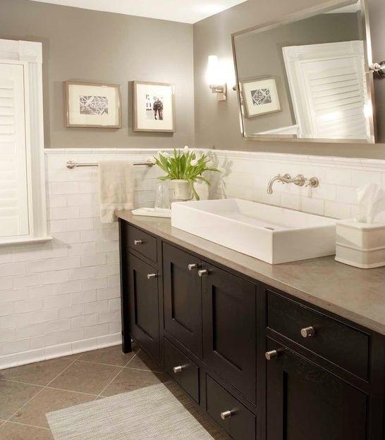 Elegant transitional bathroom wall color mirror sink subway tile floor tile laid