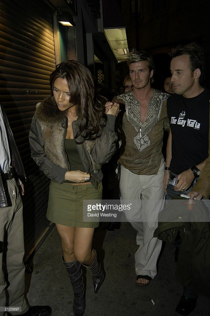 David and Victoria Beckham arrive with David Furnish at 'The Jewel' bar in Soho, London to celebrate Furnish's 40th birthday on October 21, 2002. The party was thrown by David Furnish's partner Elton John.