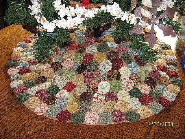 Yoyo tree skirt. I don't like the colors, but would look adorable in Christmas colors.