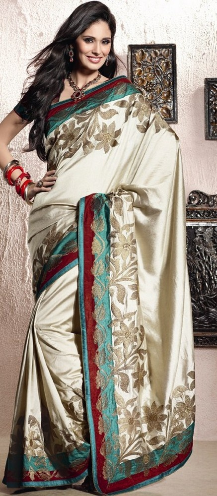 his is unstitched dress material which can be customised as per the requirement.This Cream Art Silk Saree With Blouse will give you unique style. Slight variation in color and patch patti is possible. http://www.shopcost.in/saree