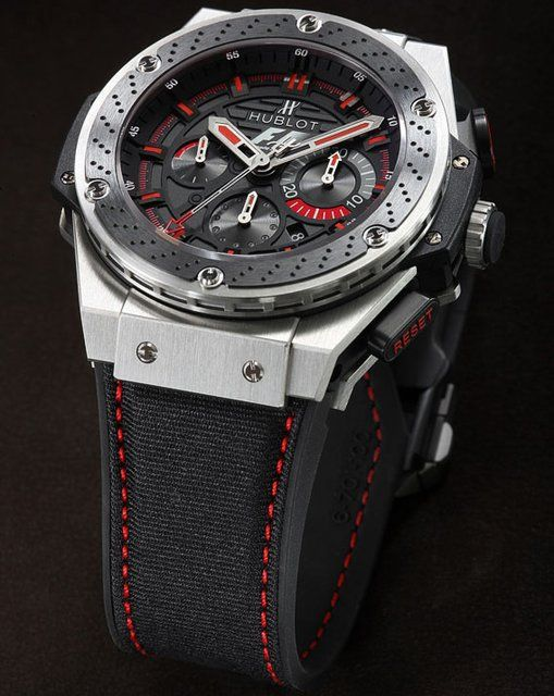 Hublot F1 King Power- Inspired 48mm case made of Zirconium with F1 logo on dial. Limited Edition - Case:Satin-finished zirconium Center sweep seconds chronograph hand, minute totalizer at 3 o'clock (30), hour totalizer at 6 o'clock (12) Crystal - Sapphire - Scratch Resistant, interior Anti-reflective - Bezel - Zirconium and ceramic, disc brake decoration with 6 H-shaped black PVD titanium screws in relief Water resistant - 100m / 330ft