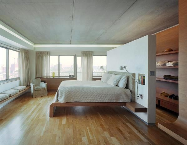 This is not a loft, but would be great to have floor to ceiling shelving hidden away behind the bed.