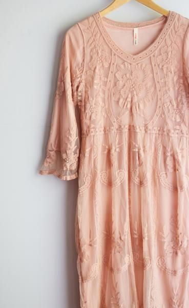 Sheer lace dress with FULLY LINED 3/4 length sleeves. Fits true to size. Made in…