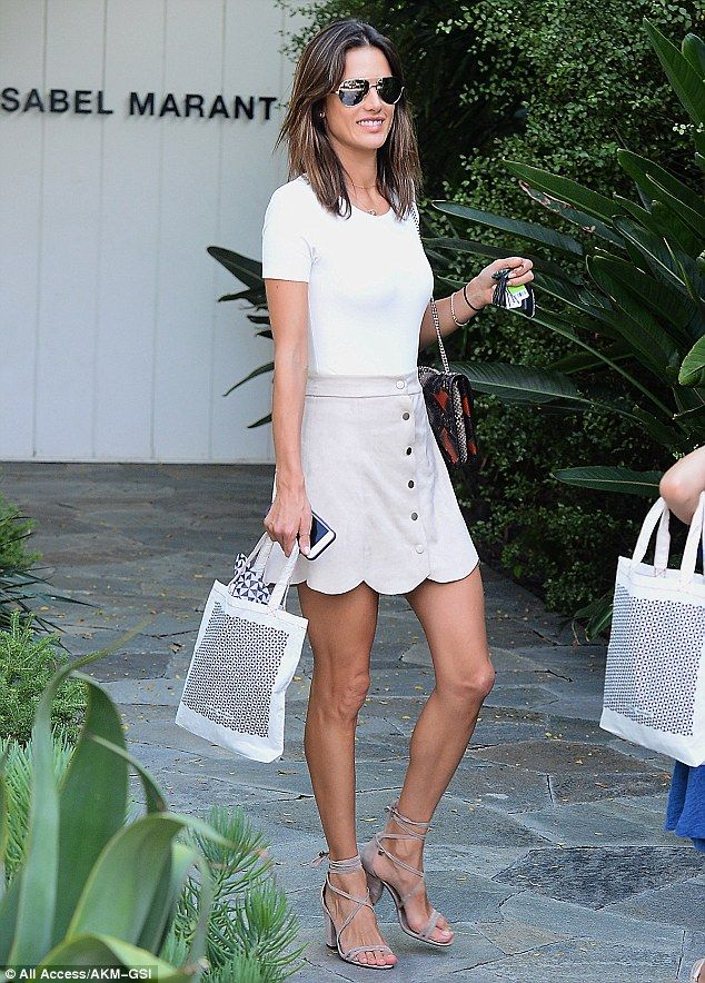 Alessandra Ambrosio shows off legs in short mini skirt as she shops