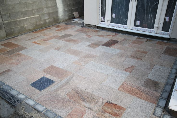 Natural Granite Paving in a Burnt Barley Colour laid in a Herring-bone design More on mvstone.ie