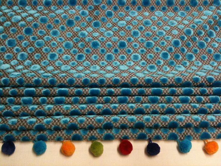 Multi coloured pompoms matched with Designer Guild velvet