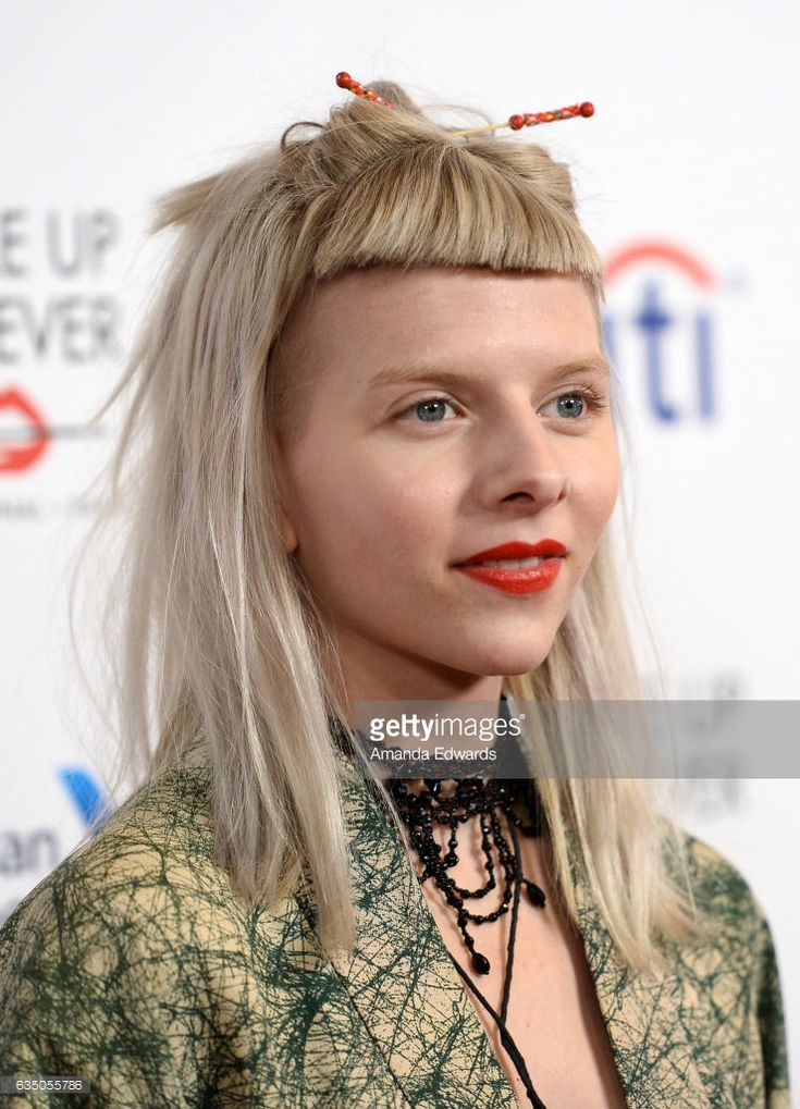 Singer Aurora arrives at the Universal Music Group's 2017 GRAMMY After Party at The Theatre at Ace Hotel on February 12, 2017 in Los Angeles, California.