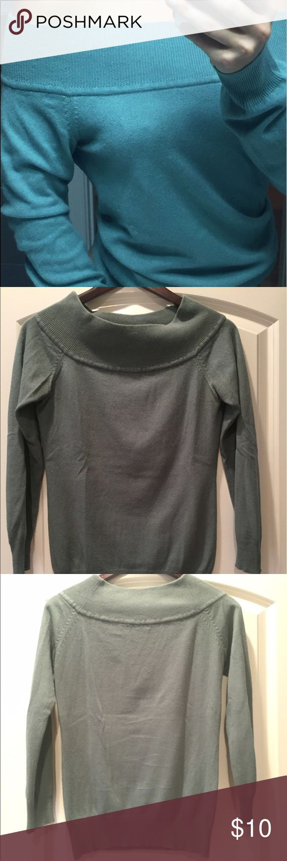 Silk and cashmere off the shoulder sweater. Goes great with high waisted jeans. Purchased off Victoria's Secret website last year. Looks better on than on hanger. Bottom band makes it easy to wear as cropped sweater or keep it at your hips. Moda International Sweaters