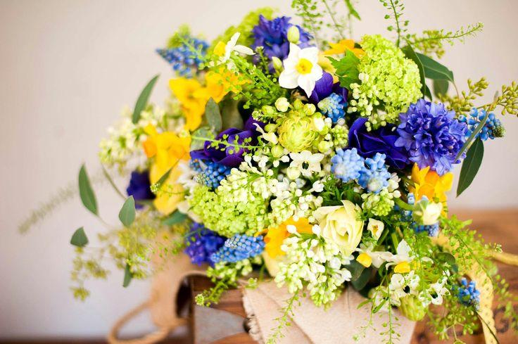 Spring Wedding Bouquet Showcasing: Blue Grape Muscari Hyacinth, Purple Hyacinth, White Lilac Buds, White/Yellow Daffodils, Yellow Daffodils, Star Of Bethlehem, Green Snowball Viburnum, Additional Coordinating Florals & Foliage