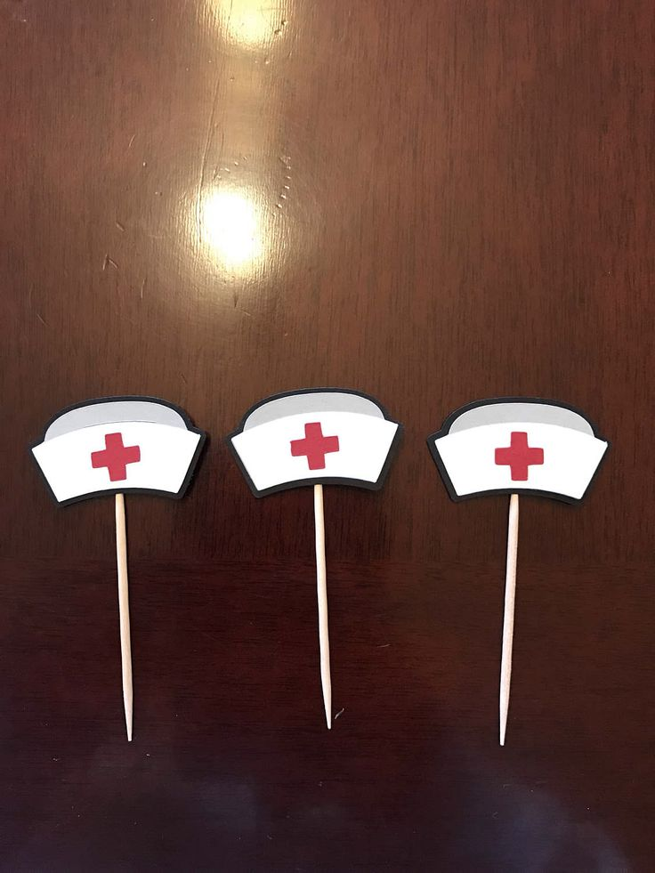 Nurses party decorations. A personal favorite from my Etsy shop https://www.etsy.com/listing/522301065/12-nurses-hat-cupcake-toppers-nurse