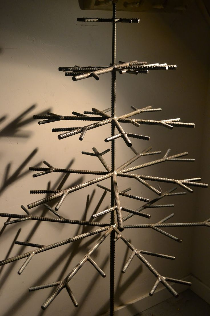 Welded Rebar Christmas Tree      Shadows       Decorated in Found Objects and Industrial Detritus                        Welded rebar ...