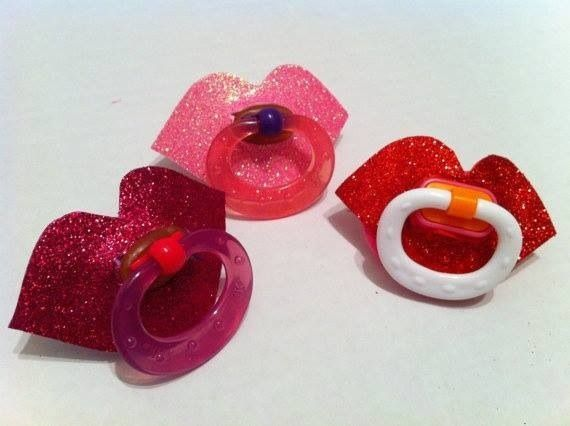 Cute lips pacifiers. I love these pacifiers, they're so cute and great for little girls. I'll have to get this for my baby girl if I have a girl in the future.