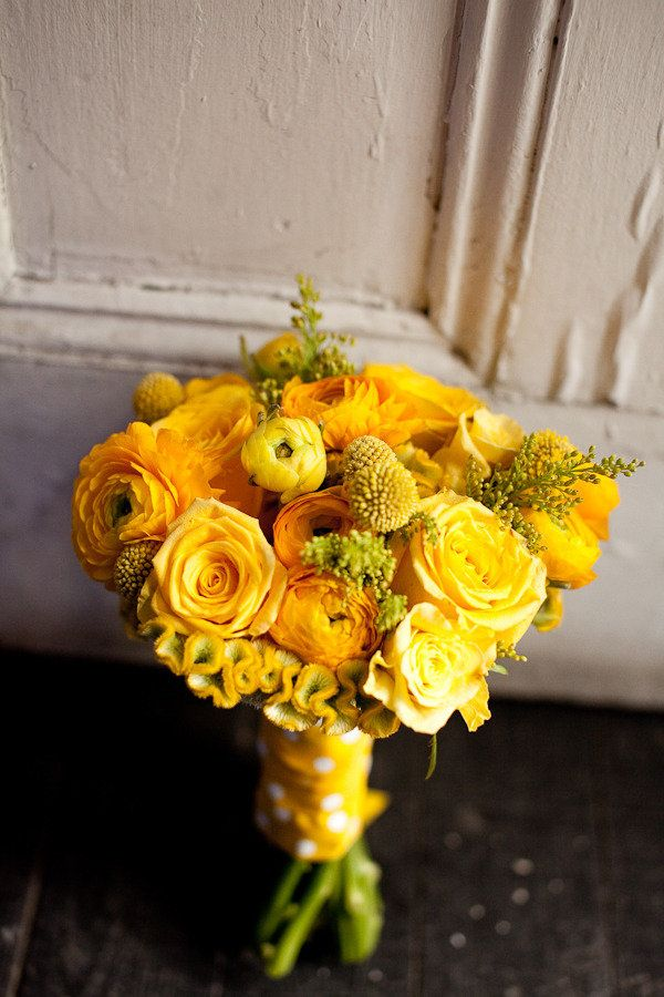 Bright yellow bouquet, photographed by Meghan Andrews Photography