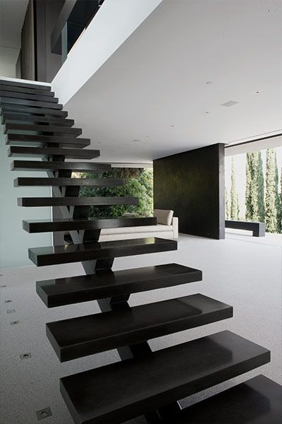 Contemporary staircase in modern Hollywood Hills home overlooking Los Angeles