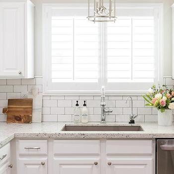 White Granite Kitchen Countertops with White Subway Tile Backsplash
