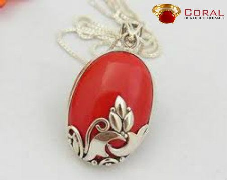 Beautiful sterling silver pendant with in built red coral gemstone