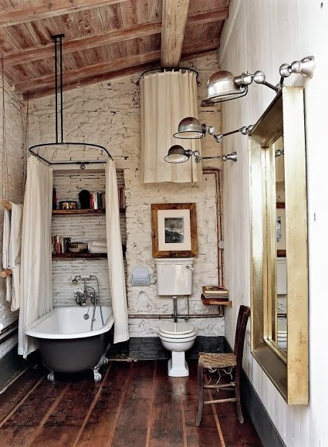 Antique tub with the curtain all the way around and suspended in air.