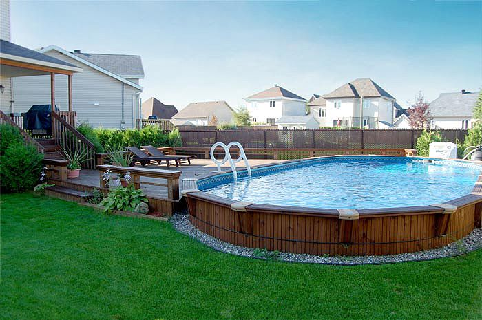Wooden above ground pools above ground wood pool packages are complete except water and for Above ground swimming pool kits