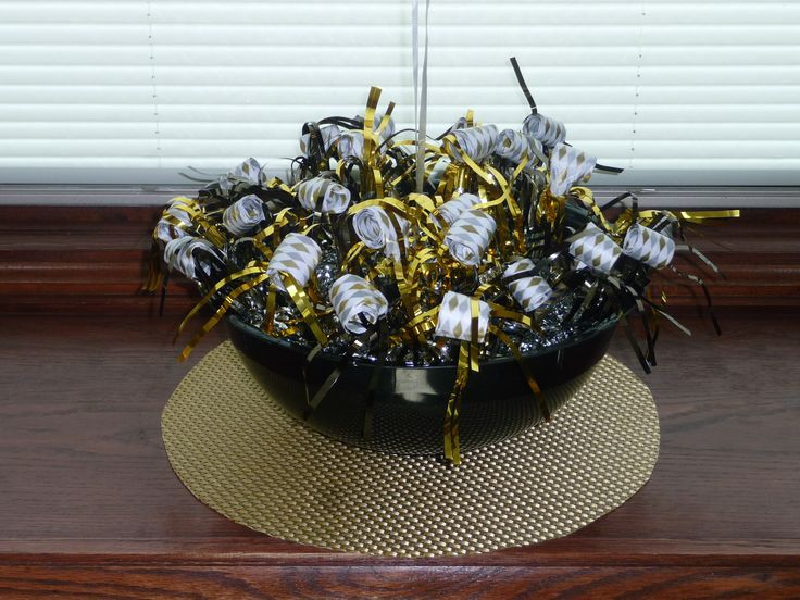 A great way to pass out noise makers at your next New Year's Eve party! Balloon Bowls are patent-pending polystyrene plastic bowls that come with an anchor loop in the bottom. Ready to tie on helium balloons and fill with snacks, candy, cookies, flowers, party loot bags to create your own fun and unique centerpieces. (12 inch diameter, 5 quart) www.balloonbowl.com