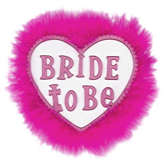 Wit met roze broche met de tekst: Bride to be. Leuk voor een vrijgezellen feest! Diameter: ongeveer 8 cm.