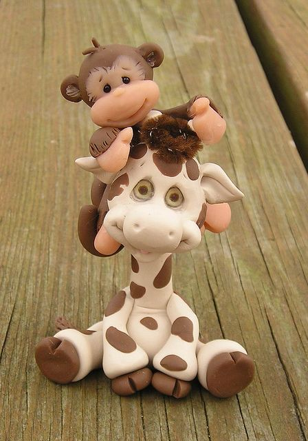 Cute monkey...the giraffe's eyes are so creepy though!