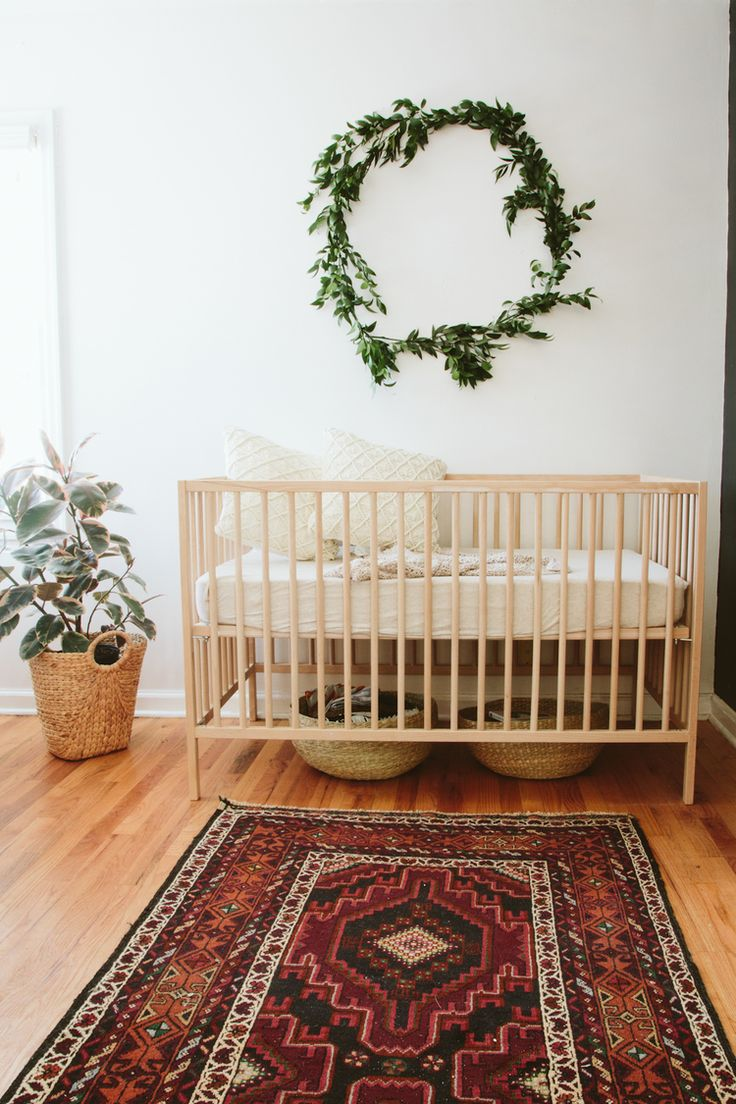Paige Jones // www.paigejones.us // sweet calming nursery with beautiful wreath and green dresser