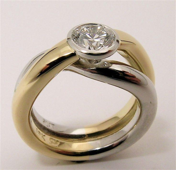 18k gold and platinum heavy wire overlap bezel set Canadian Diamond Engagement Ring. 1/2 Carat Diamond.