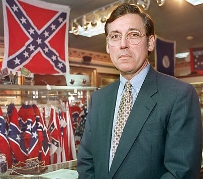 Pictured: Glenn McConnell at his family's memorabilia store in 1999. After the former SC Senator defended restaurant for refusing to serve blacks based of owner's sincerely held religions beliefs, McConnell went on to defend the flying of the Confederate flag on the SC state capital and was recently appointed to be President of the College of Charleston. His job is now to 'educate' young Southerners...