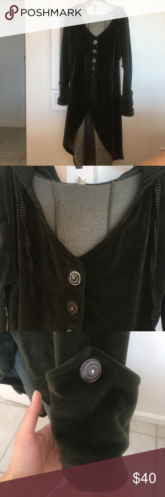 """Long velvet dark green coat/jacket Dark green long velvet jacket. With hood. Wooden buttons. Handmade in Nepal. Size medium. It is kinda big on me and I am 5""""7 135 36A waist 28 hips 38 only wore once for a catalog shoot. Very warm Avatar Jackets & Coats Trench Coats"""