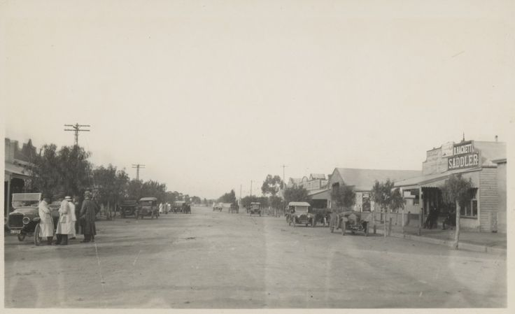 Unidentified country town, Mallee Wimmera district, ca.1925. Photo: State Library of Victoria's Victorian Railways Reso Tour photographs. Probably Roy Street Jeparit with the railway crossing in the background Hindmarsh Hotel & David Hackett's saddlery on the right.