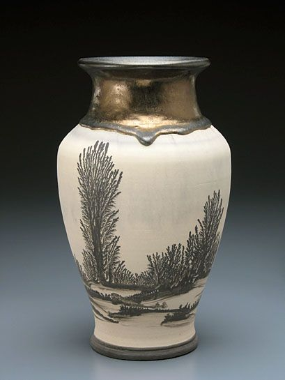 The vase shown here is an example of Vic's work with 'mocha diffusion'... a process that results in beautiful tree-like patterns. Vic manages to control this seemingly random process to create lovely landscaped pots with rich interior glazes that frequently also decorate the rims.