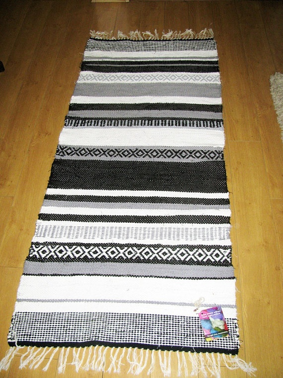 Handwoven black and white cotton rag rug by DzevStudio on Etsy, $99.00