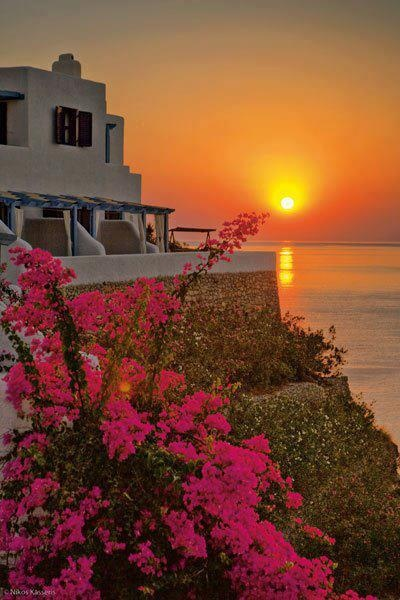 Sunset, borganvilla in Tilos island, Greece.  Go to www.YourTravelVideos.com or just click on photo for home videos and much more on sites like this.