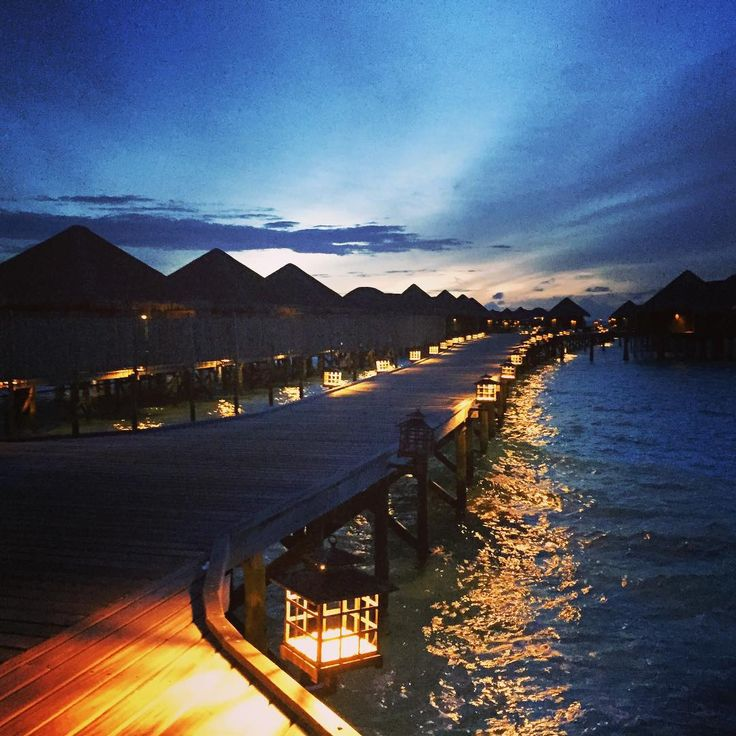 A stroll along the jetty - you're water villa is this way...