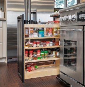 In a modern kitchen preparing healthy meals sometimes requires a long list of ingredients that may be out of reach when you need them most. Horizontal and vertical spice racks installed inside drawers keep them within easy reach when you need them but neatly out of sight when you don't.