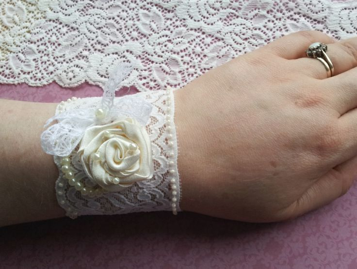 Handmade vintage lace wrist cuff with ivory ribbon rose and beading handmade by Beautiful Unique