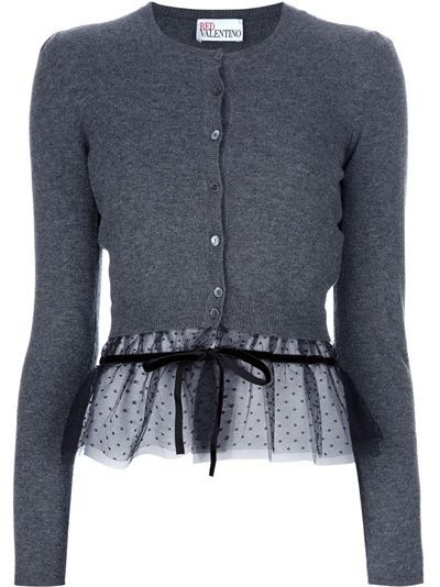 Grey wool cardigan from Red Valentino featuring a round neck, a central front button fastneing, long fitted sleeves, a sheer black polka-dotted hem section with a grosgrain bow detail. This would be a cute mod for a too-short sweater!