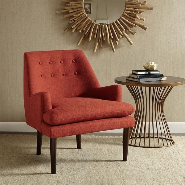 A modern update is this mid century club chair with its smooth silhouette and inviting shape; the persimmon coloring makes for the perfect color coordination to any room. Set includes: One chair Frame