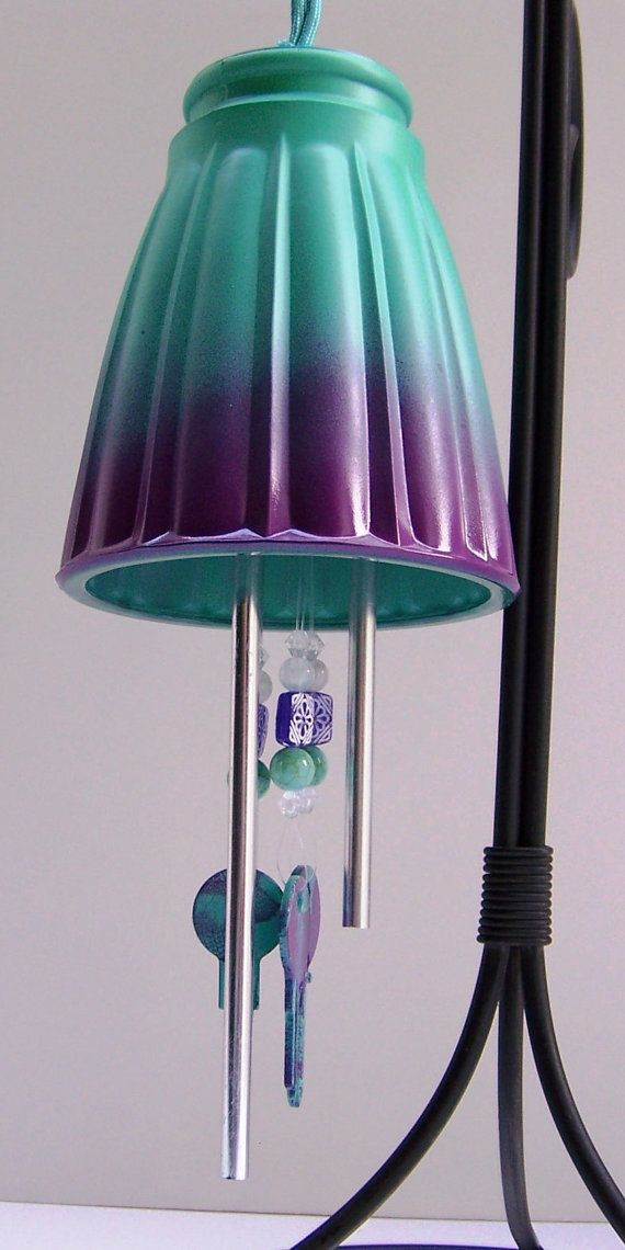 This green and purple light shade wind chime will produce a delicate tinkling sound when touched by the wind. A painted light shade, painted keys