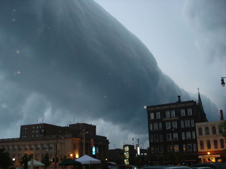 Wisconsin....What kind of cloud is this? A type of arcus cloud called a roll cloud. These rare long clouds may form near advancing cold fronts. In particular, a downdraft from an advancing storm front can cause moist warm air to rise, cool below its dew point, and so form a cloud.