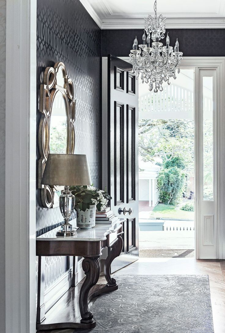 A vintage chandelier and gold mirror create a glamorous foyer in this colonial-style Queenslander. Photography: Maree Homer | Stylist: Kate Nixon | Story: Australian House & Garden