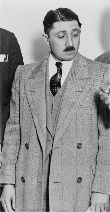 Frank Nitti 1881-1943 Chicago gangster who was convicted of tax evasion with Al Capone. He was been portrayed in several films by Sylvester Stallone in CAPONE 1975 by Stanley Tucci in ROAD TO PERDITION 2002 by Bill Camp in PUBLIC ENEMIES 2009 .