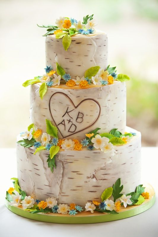 "birch bark with initials cake! Love this idea, but instead of birch have one with brown bark for ""chocolate"" cake and orange leaves on tiers. Doves on top? ""Love birds"""