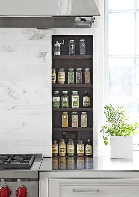 "I like the eclectic containers.  Hideaway Spice Rack - ""A kitchen needs to work,"" De Giulio says. ""That is the one hard-and-fast rule of good kitchen design. Each material, each object, each work zone must function extremely well, and the materials, in particular, must be durable."" In the range area, sliding panels reveal handy spices. When closed, it's a sleek marble-tile backsplash."