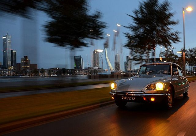 Moonlight drive...    ...comfortably Rotterdam...    A 1972 Citroën DS21 Pallas floating over the 'Maasboulevard' in Rotterdam.  You can see the nice Rotterdam skyline on the background with the famous Erasmusbridge.